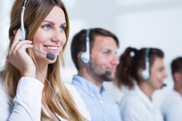Smiling Call Center Representatives on Headphones