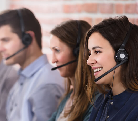 Smiling Contact Center Representatives on Headsets