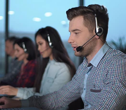 Call Center Representatives Wearing Headsets